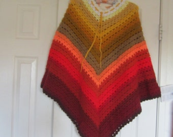 """One of a kind Adult size """"rainbow"""" poncho in white, yellow, tan, orange and red."""