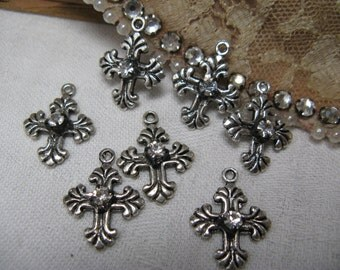 7 silver crosses with rhinestone