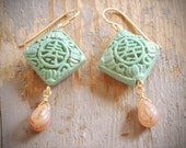 long life mint cinnabar lantern earrings. light green cinnabar & buff swirled glass drops on gold fill by val b.
