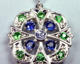 Argentium silver pendant,set with sapphires and garnets
