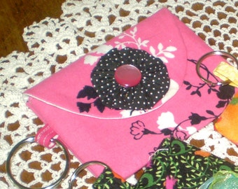 Pink, black and white ladies wallet- black and white polka dot yoyo and button decoration- Velcro closure- key ring