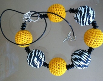Black and Yellow Raffia and Crochet Bead Necklace on Leather Cord