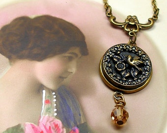 Antique BUTTON necklace, 1800s Victorian BIRD on brass chain. Antique button jewelry, jewellery.