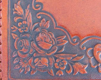 Amazing vintage embossed leather cover