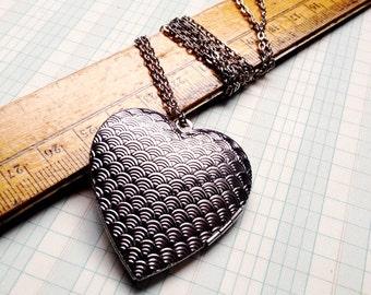 long locket necklace -   large silver heart decorative pattern