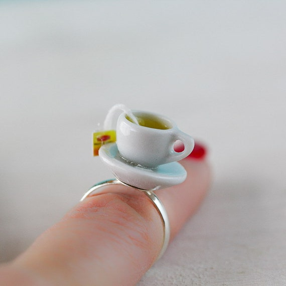 cup of lemon lipton tea adjustable ring tea ring cup by