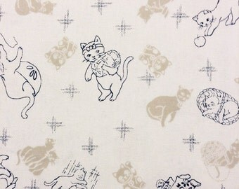 Clever Kittens in beige and white Japanese quilt cotton