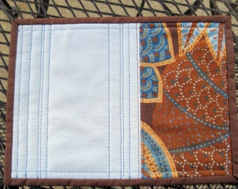 """Mug rug, quilted, blue and brown, 9 1/2"""" x 7"""". Hot pad."""