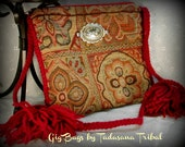 Tan and brown gig bag with maroon colored strap and tassels