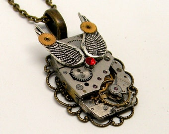 Steampunk jewelry. Steampunk necklace pendant with angel wings and vintage watch.