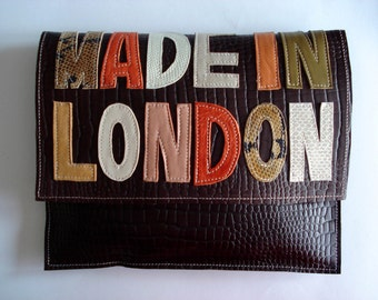 Handmade City Clutch in brown croc embossed leather with mixed applique text