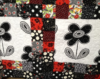 Red, black and white flower quilt
