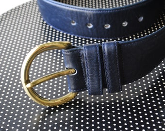 Military style vintage 80s dark navy blue , genuine leather, wide belt. Made by Cipriani.Size S-M.