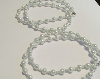 two Glass creamy pearls
