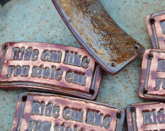 Ride em like you stole em...a handmade pottery cuff bead with an attitude in copper brown