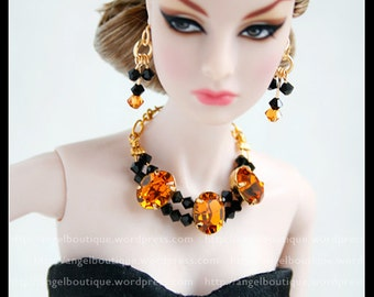 Statement Bib Necklace with Swarovski Crystal and matching earrings.