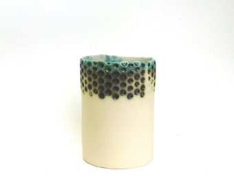 hand built porcelain vessel   ...   lots of dots
