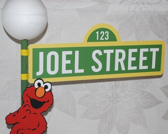 Sesame Street Sign with Lamppost and Elmo character