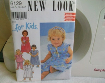 Childs night gown and pajamas pattern #6129 Sizes 6 months to 4 New and Unused