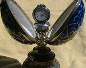 This is a beautiful, decorative  time piece, with a music box
