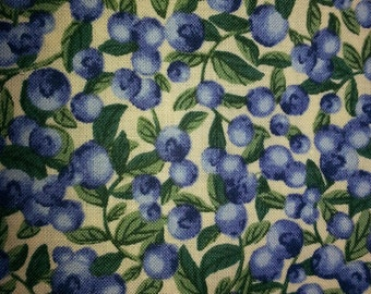 Blueberry print fabric on a cream background.