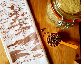 """wood block print """"brown and white in trees"""" tea towel by color.joy."""
