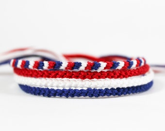 Four Thin Handmade Bracelets in Red, White, and Blue