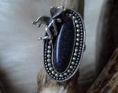 sterling silver fairy ring with an oval blue goldstone in size 6 1/2
