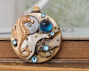 steampunk necklace - UNDER THE SEA - vintage pocket watch movement necklace with seahorse charm and aquamarine color Swarovski rhinestones