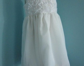 White Special Occasion Dress With Petals In The Hem Of The Overskirt