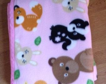 Pink woodland creatures blanket