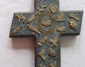 vintage painted wooden cross with metal milagros