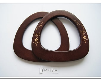 a pair of brown wooden purse handles