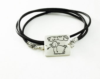 Childs Artwork Bracelet made of Fine Silver and Leather