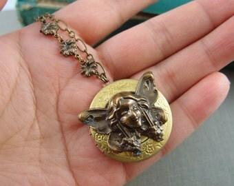 Vintage winged angel locket, aged brass locket, round locket, N017