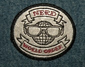 Nerd World Order Mini Iron on Patch on Cowhide Leather