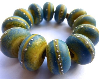 12 Hand Made Matte Bead Set in Opaque Ocher/Blue Enamel with Fine Silver Droplets  by SRA Sarah Klopping