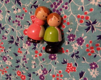 wee wooden boy and girl