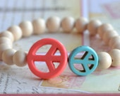 Premade turquoise peace sign and wooden bead stretch bracelet