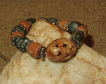 Moss Agate Stretch Bracelet with Carved Soapstone Focal Bead and Cross Charm