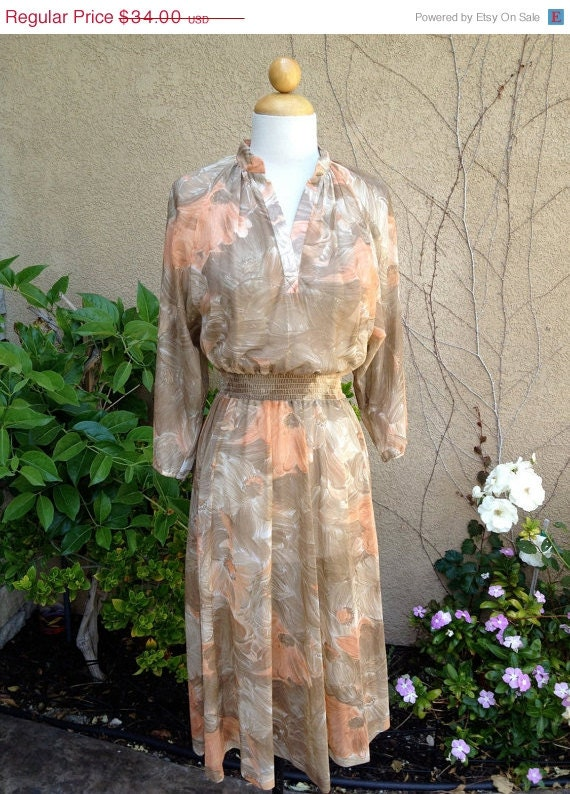 Clearance sale A vintage 1960s 1970 semi sheer taupe and peach dolman sleeves smocked waist floral dress size XS S