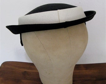 The 1960's Black and White Flat Skimmer Hat