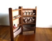Folding sewing station storage cabinet