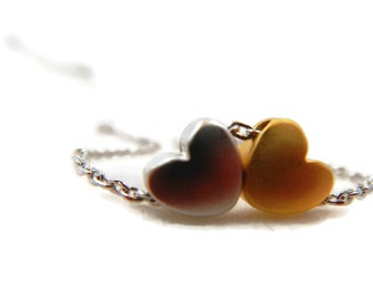 """Two Hearts """"Opposites Attract"""" Necklace"""