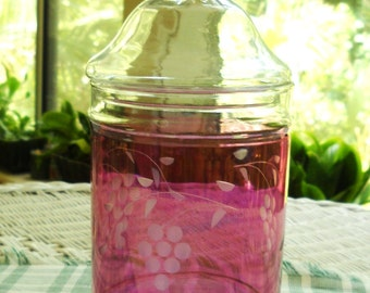 vintage apothecary jar   cranberry with grape motif