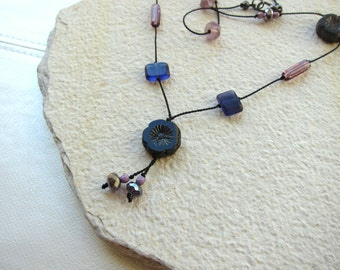 Purple on black hand knotted silk necklace with limited edition Czech beads
