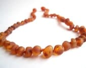 Maximum Effective Raw Unpolished Baltic Amber teething necklace for your baby handmade knotted .Cognac colour amber.