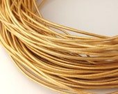 LRD0105042) 1 meter of 0.5mm Gold Metallic Round Leather Cord