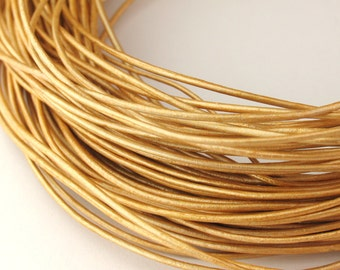 LRD0105042) 0.5mm Gold Genuine Metallic Round Leather Cord.  0.8 meter, 1.5 meters, 4.1 meters.  Length Available.