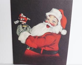 Vintage Gibson Christmas card Santa Claus holding a Santa doll